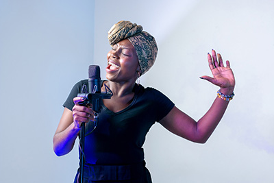Image: black female singer with microphone